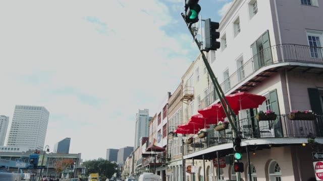 decatur street in downtown new orleans (french quarter) in the morning - new orleans mardi gras stock videos and b-roll footage