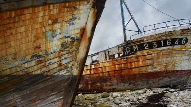 decaying trawlers in the harbour at camaret sur mer, finistere, france. - rotting stock videos and b-roll footage