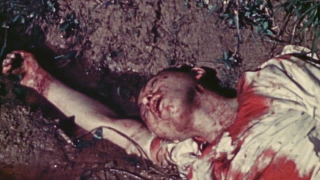 ha deceased islander lying in a ditch during wwii / okinawa japan  - stained stock videos & royalty-free footage