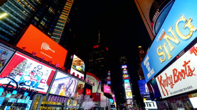 display of electronic billboard advertisements in times square at night / midtown manhattan broadway and seventh avenue new york city usa - broadway manhattan video stock e b–roll