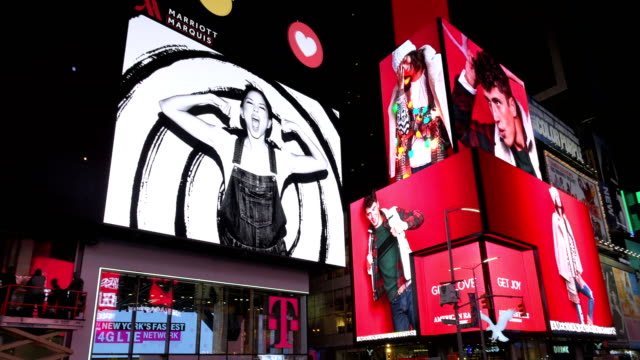 display of electronic billboard advertisements in times square at night / midtown manhattan broadway and seventh avenue new york city usa - electronic billboard stock videos and b-roll footage