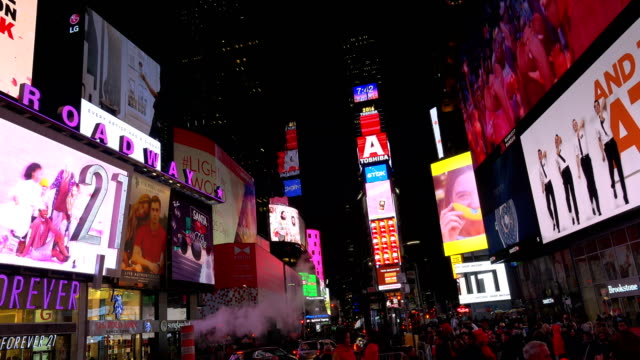 december 08, 2016: display of electronic billboard advertisements in times square at night / midtown manhattan, broadway and seventh avenue, new york... - electronic billboard stock videos & royalty-free footage