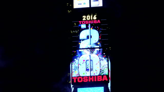 the new year's eve ball will drop at one times square atop of the toshiba tower / shown here is the exact location of the ball drop and the neon... - digital clock stock videos & royalty-free footage