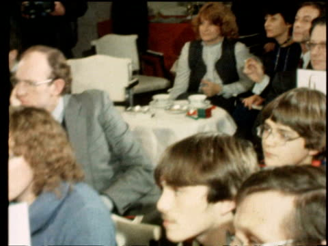 december 12 1981 film montage cu zo teenage boy working against clock at rubik cube championships/ ms audience/ ms erno rubik at table/ ms zi man... - 1981年点の映像素材/bロール