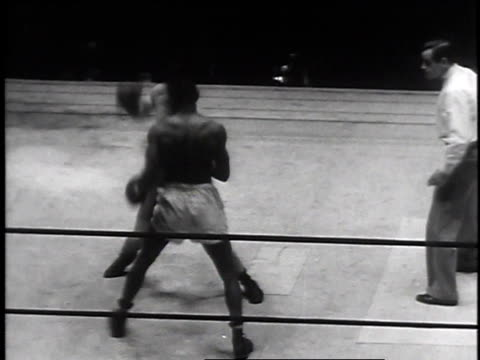 december 16, 1935 boxers in a ring throwing punches with referee looking on / new york, new york - 1935 stock videos & royalty-free footage