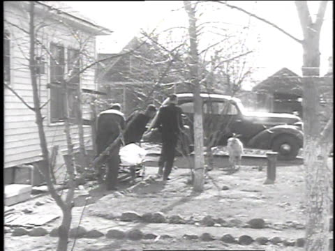December 16 1935 WS Small casket and covered stretcher being carried out of house / Snyder Oklahoma