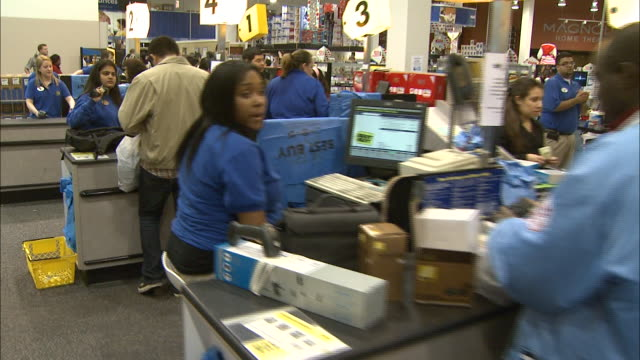 december 16 2010 ds best buy employees serving customers in numerous checkout lanes / united states - レターボックス点の映像素材/bロール