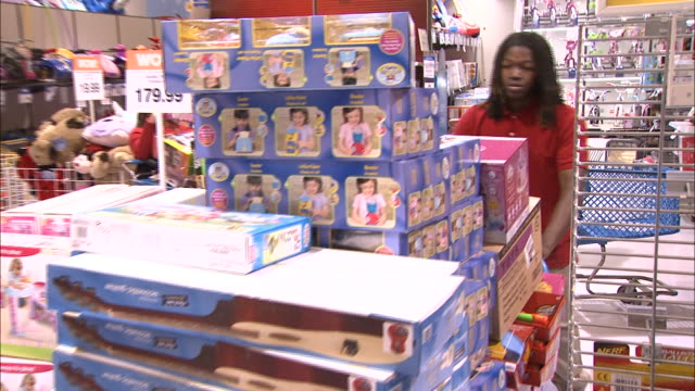december 16 2010 ts store associate pushing cart overloaded with boxes through crowded toy store / united states - toy store stock videos and b-roll footage