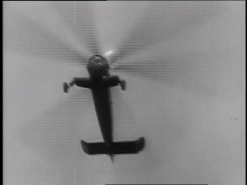 December 18 1935 MONTAGE Autogyro helicopter flying then landing / Washington DC United States