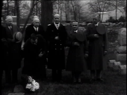 stockvideo's en b-roll-footage met december 18, 1935 montage group of people standing in cemetery and placing flowers on wilbert wright's grave / dayton, ohio, united states - 1935