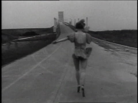 december 18, 1935 ws woman ballet dancer walking on her toes down the street / buffalo, new york, united states - en pointe stock videos and b-roll footage