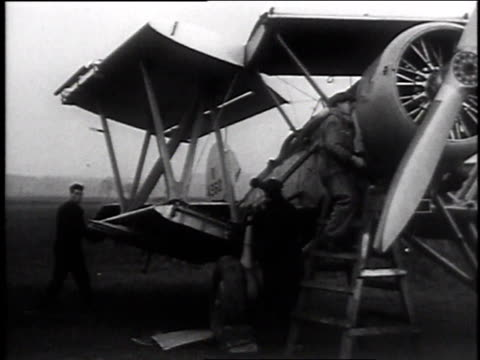 december 19, 1935 montage men assembling fairey swordfish bombers with folding wings for raf/ brough, england, - 1935 stock videos & royalty-free footage