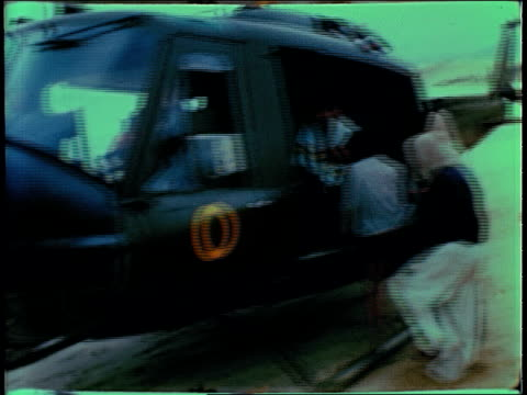 december 19 1967 ts helicopter landing soldiers herding civilians aboard while one tries to escape then lifting off again / bong son south vietnam - south vietnam stock videos and b-roll footage