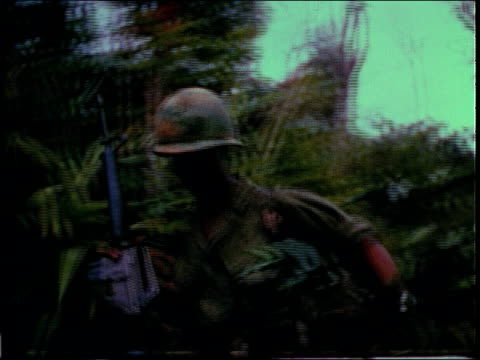 December 19 1967 MONTAGE infantry soldiers advancing in jungle / Bong Son South Vietnam