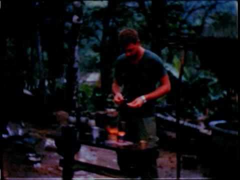 december 19, 1967 soldier preparing hot drink / bong son, south vietnam - south vietnam stock videos & royalty-free footage
