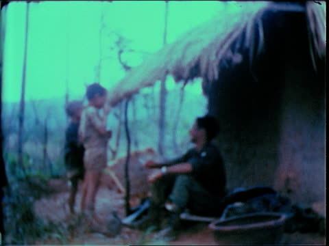 december 19 1967 ws soldier teaching two children to smoke / bong son south vietnam - south vietnam stock videos & royalty-free footage