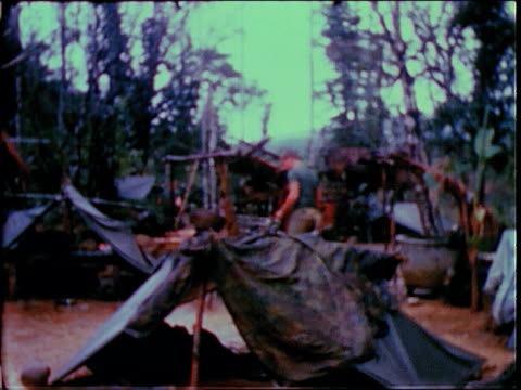 december 19, 1967 soldiers in makeshift camp / bong son, south vietnam - 南ベトナム点の映像素材/bロール