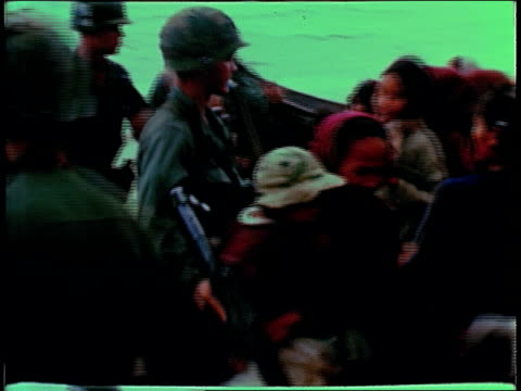december 19, 1967 soldiers moving crowd of women and children / bong son, south vietnam - 南ベトナム点の映像素材/bロール