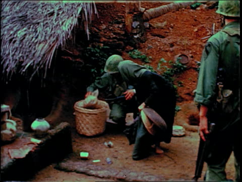december 19, 1967 soldiers searching a village and questioning civilians / bong son, south vietnam - south vietnam stock videos & royalty-free footage