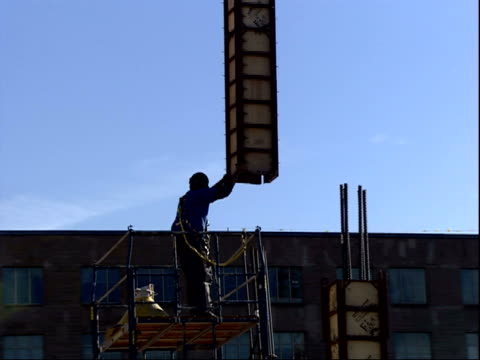 december 19, 2001 crane and construction worker lowering support beam into position at pentagon rebuilding site / arlington, virginia, united states - lowering stock videos & royalty-free footage