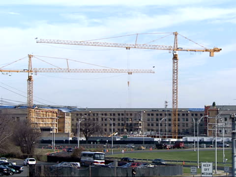 december 19 2001 montage crane operating outside pentagon during rebuilding after 9/11 with traffic in the foreground / arlington virginia united... - rebuilding stock videos & royalty-free footage