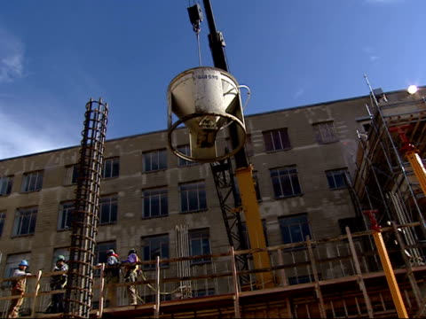 december 19, 2001 montage workers steadying large cement bucket hoisted by crane during pentagon rebuilding after 9/11 / arlington, virginia, united... - rebuilding stock videos & royalty-free footage