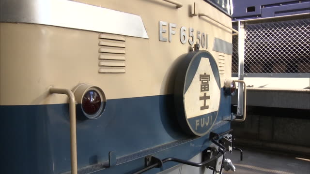 december 19 2014 railfans on the platform taking photos of fuji limited express train with sleeping berths nicknamed blue train which is specially... - waterproof clothing stock videos and b-roll footage