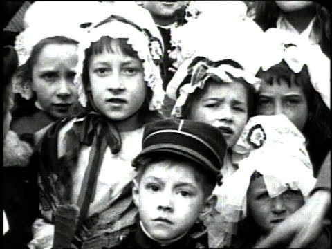 december 1918 cu children dressed in traditional alsatian costume watching a military decoration ceremony / metz france - metz stock videos and b-roll footage