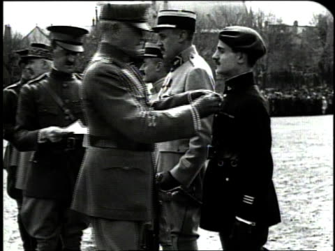 december 1918 ms general john pershing pinning medals on the lapel of soldiers from the french army / france - 1918 stock videos and b-roll footage