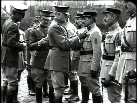 december 1918 montage general john pershing awarding medals to soldiers in the french army / france - john pershing stock videos & royalty-free footage
