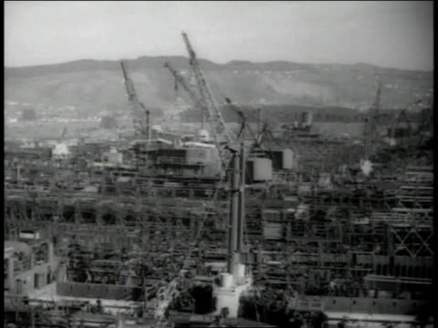 December, 1942 AERIAL Kaiser Shipyard with cranes towering over the yard / Richmond, California, United States