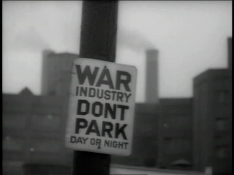 December 1942 WS Sign in front of factory stating War Industry Don't Park Day or Night / Akron, Ohio, United States