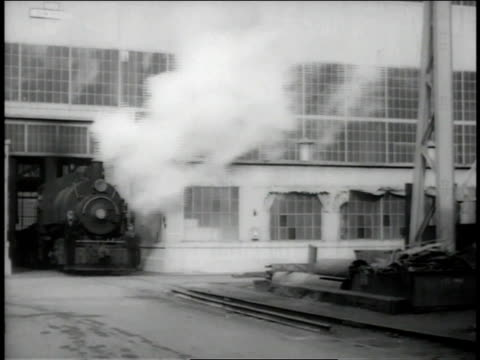 vídeos y material grabado en eventos de stock de december 1942 ws smoking train exiting factory building / long beach, california, united states  - locomotora