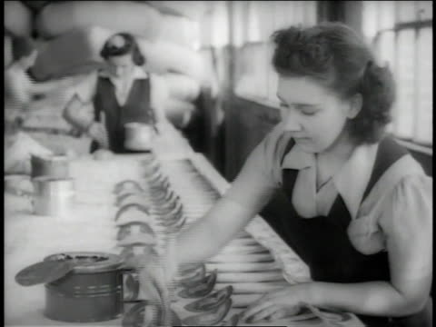 december, 1942 ms women gluing parts to a rubber life raft at a goodyear factory / akron, ohio, united states - 1942 stock videos & royalty-free footage