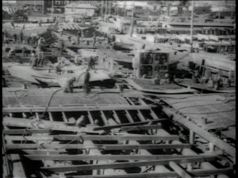 December, 1942 WS workers assembling ships at the Kaiser Shipyard / Richmond, California, United States
