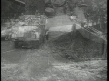 vidéos et rushes de december 1944 montage battle of the bulge combat action scenes as german tanks and troops are counterattacking, soldiers riding in trucks and walking... - 1944
