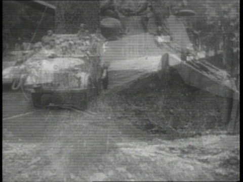 december 1944 montage battle of the bulge combat action scenes as german tanks and troops are counterattacking, soldiers riding in trucks and walking... - 1944 bildbanksvideor och videomaterial från bakom kulisserna