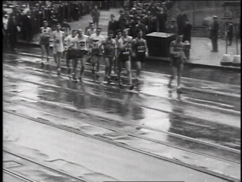 december 2, 1935 crowd watching large group of men speed walking through rainy streets / new york, new york - 1935 stock videos & royalty-free footage