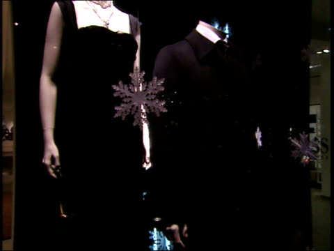 December 2 2006 MONTAGE Hugo Boss storefront with pedestrian walking by / United States