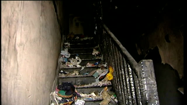 norwood grove int burned out staircase in bimpson home following the fire charred remains in living room including christmas tree close shot of fire... - francesca bimpson stock videos & royalty-free footage