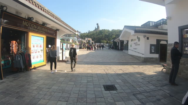 ngong ping, hong kong - 17 december 2018 time lapse the enormous tian tan buddha at po lin monastery in hong kong 17 december 2018 - tian tan buddha stock videos and b-roll footage