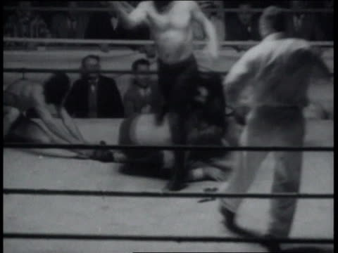 december 23, 1936 blindfolded wrestlers in free-for-all / united states - blindfold stock videos & royalty-free footage