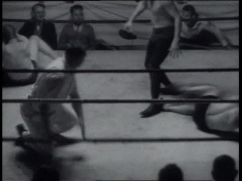 December 23, 1936 Blindfolded wrestlers in free-for-all, with referee being hit / United States