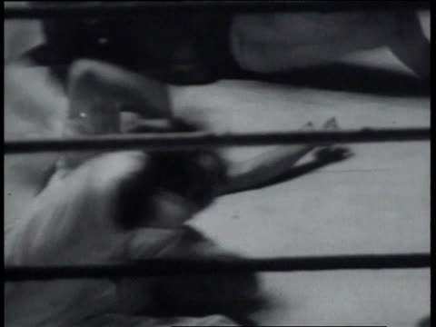 December 23, 1936 Blindfolded wrestlers in free-for-all, with referee being hit and finally hitting back / United States