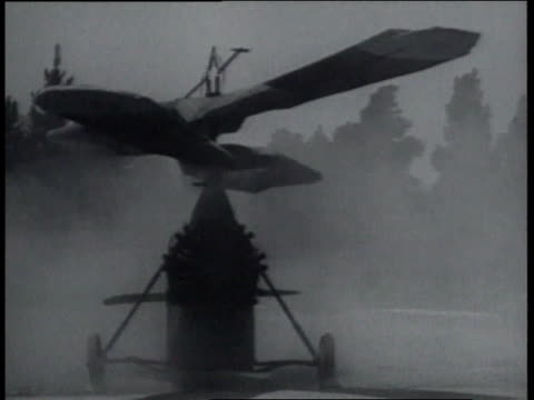 december 23, 1936 ws early attempt at a helicopter refuses to get off the ground - モノクロ点の映像素材/bロール