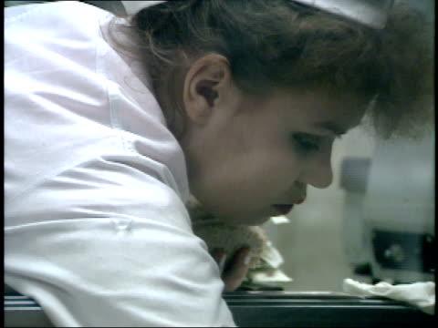 vídeos de stock e filmes b-roll de december 23 1987 ms employee organizing meat in display case at smolensky state market / moscow russia - cristaleira