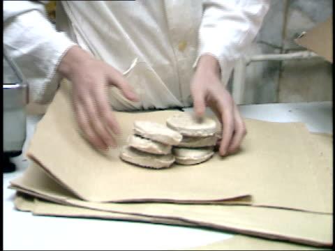 december 23, 1987 employee wrapping meat for a customer at smolensky state market / moscow, russia - skåp med glasdörrar bildbanksvideor och videomaterial från bakom kulisserna