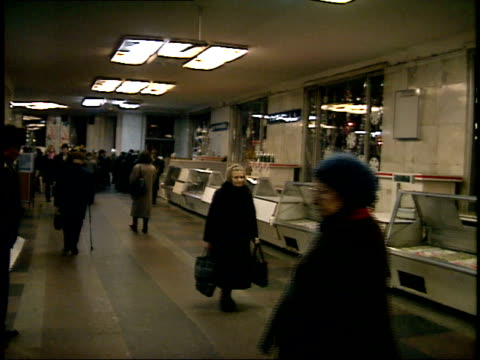 December 23 1987 MONTAGE Large group of customers walking past empty displays in the Smolensky State Market / Moscow Russia