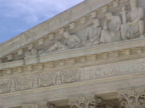 december 29 2006 pan pediment carvings and 'equal justice under law over western facade of the supreme court building / washington dc united states - architrav stock-videos und b-roll-filmmaterial