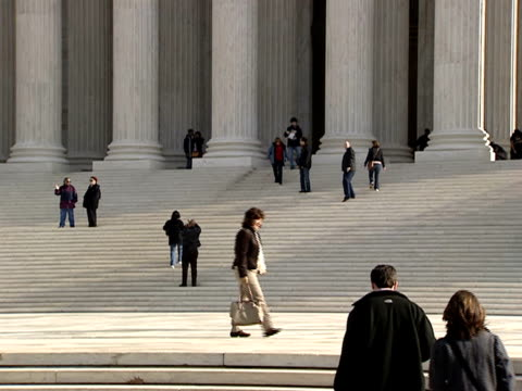 december 29 2006 tu tourists walking below 'equal justice under law carving on western facade of the supreme court building / washington dc united... - architrav stock-videos und b-roll-filmmaterial